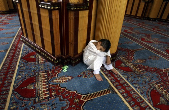 Taking a nap during Taraweeh, from Ramadan 2009, the Big Picture.